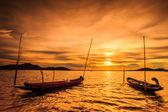 Sunset at sea and boats — Stock Photo