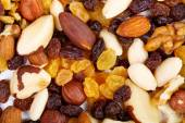 Background from mixed nuts and sultanas — Stock Photo