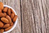 Almonds on a white plate. — Stock Photo