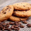 Cookies and coffee beans on a wooden table. — Stock Photo #68603279