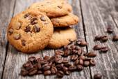 Cookies and coffee beans on a wooden table. — Stock Photo