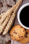 Cup of coffee with cookies and wheat on a wooden table. — Stock Photo
