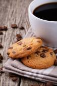 Tasty cookies and coffee cup on a wooden table. — Stock Photo