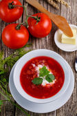Tasty soup with bread on a wooden background. — Stock Photo
