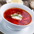 Tasty soup with bread on a wooden background. — Stock Photo #70821841