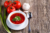 Borsch with bread on a wooden background. — Stock Photo