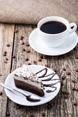 Chocolate dessert with coffee cup and coffee beans on wooden bac — Stock Photo