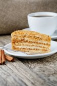 Tasty honey cake on wooden background. — Stock Photo
