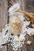 The oat flakes in jar with sugar on lace napkin. — Foto de Stock