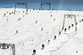 Skiing people, the chair lifts and rope tow systems of Zell am See ski region in Austria — Stock Photo