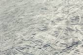Snow background with ski and snowboard tracks — Stock Photo