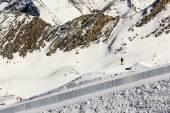 Lonely man resting in one of most popular ski resort in Alps — Foto de Stock