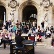 Unknown street pianist entertains the audience — Stock Photo #57852567