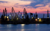 Harbor cranes at sunset. — Stock Photo