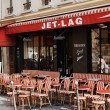 Colorful tables and chairs in sidewalk cafe Paris, — Stock Photo #58399263