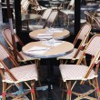Colorful tables and chairs in sidewalk cafe Paris, — Stock Photo #58399331