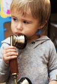 Child with a vintage telephone — Stock Photo