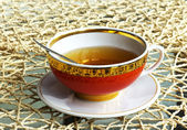 Tea in red cup — Stock Photo