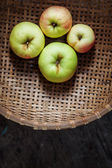 Four apples in a basket — 图库照片