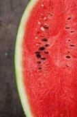 A half of watermelon on a dark table — 图库照片