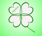 Four leaf clover in green made of hearts — Stock Photo