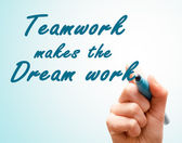 Hand with pen writing team work makes the dream work — Stockfoto