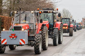 Demonstration by angry farmers with rows of tractors — Stock Photo