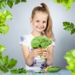 Girl eats vegetables — Stock Photo #53162545