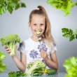 Girl eats vegetables — Stock Photo #53162555
