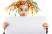 Surprised little girl holding a poster — Stockfoto