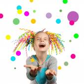 Joyful girl catches multi-colored confetti — Stock Photo