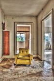 Yellow armchair in an abandoned house — Stock Photo