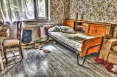 Derelict squat room in an abandoned hospital — Stock Photo