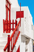 Red bannister and gate of a typical house in Mykonos — Stock Photo