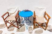 Welcoming chairs and blue table outside a bar in Mykonos — Stock Photo