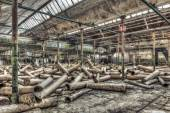 Cardboard rolls in an abandoned warehouse — Foto de Stock