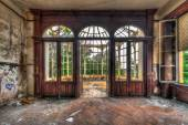 Abandoned room with view through beautiful broken conservatory — Stock Photo