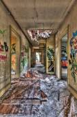 Decayed hallway in an abandoned building — Stock Photo