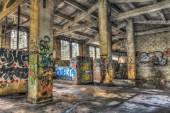 Empty derelict warehouse with concrete pillars — Stock Photo