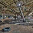 Dilapidated warehouse in an abandoned factory — Stock Photo #56582147