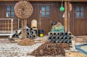 Fishing equipment and octopus pots in front of a fisherman hut i — Stock Photo