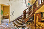 Decaying staircase in an abandoned manor — Stock Photo