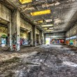 Dilapidated warehouse in an abandoned factory — Stock Photo #68077233