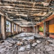 Dilapidated function room in an abandoned hotel — Stock Photo #70114267