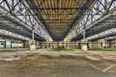 Empty warehouse in an abandoned factory — Stock Photo