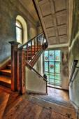 Stairway with stained glass windows in an abandoned manor — Stock Photo