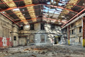 Collapsed roof in an abandoned factory warehouse — Stock Photo