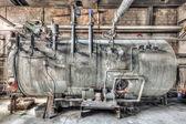 Industrial boiler in a derelict factory — Stock Photo
