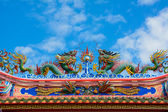 Beautiful Chinese dragon with blue sky — Stock Photo