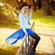 Pretty blonde girl in blue dress outdoors — Stock Photo #55097781